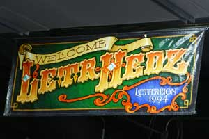Hand-lettered and Airbrushed Banner by Southpaw Signs